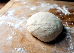 whole wheat, no knead pizza dough recipes that makes 4 one pound crusts. Can be stored in refrigerator up to 12 days.
