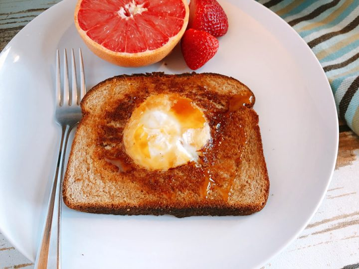 eggd in a basket with side of fruit