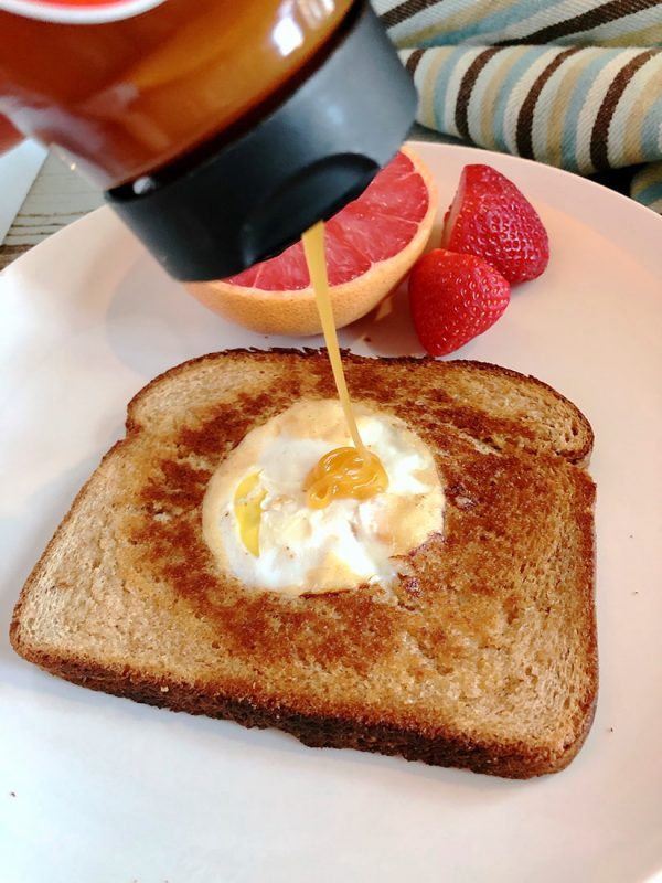 eggs in the middle of toast with honey