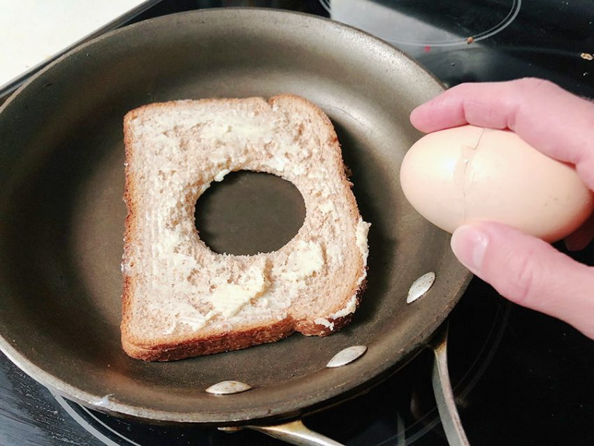 buttered toast in a skillet, egg