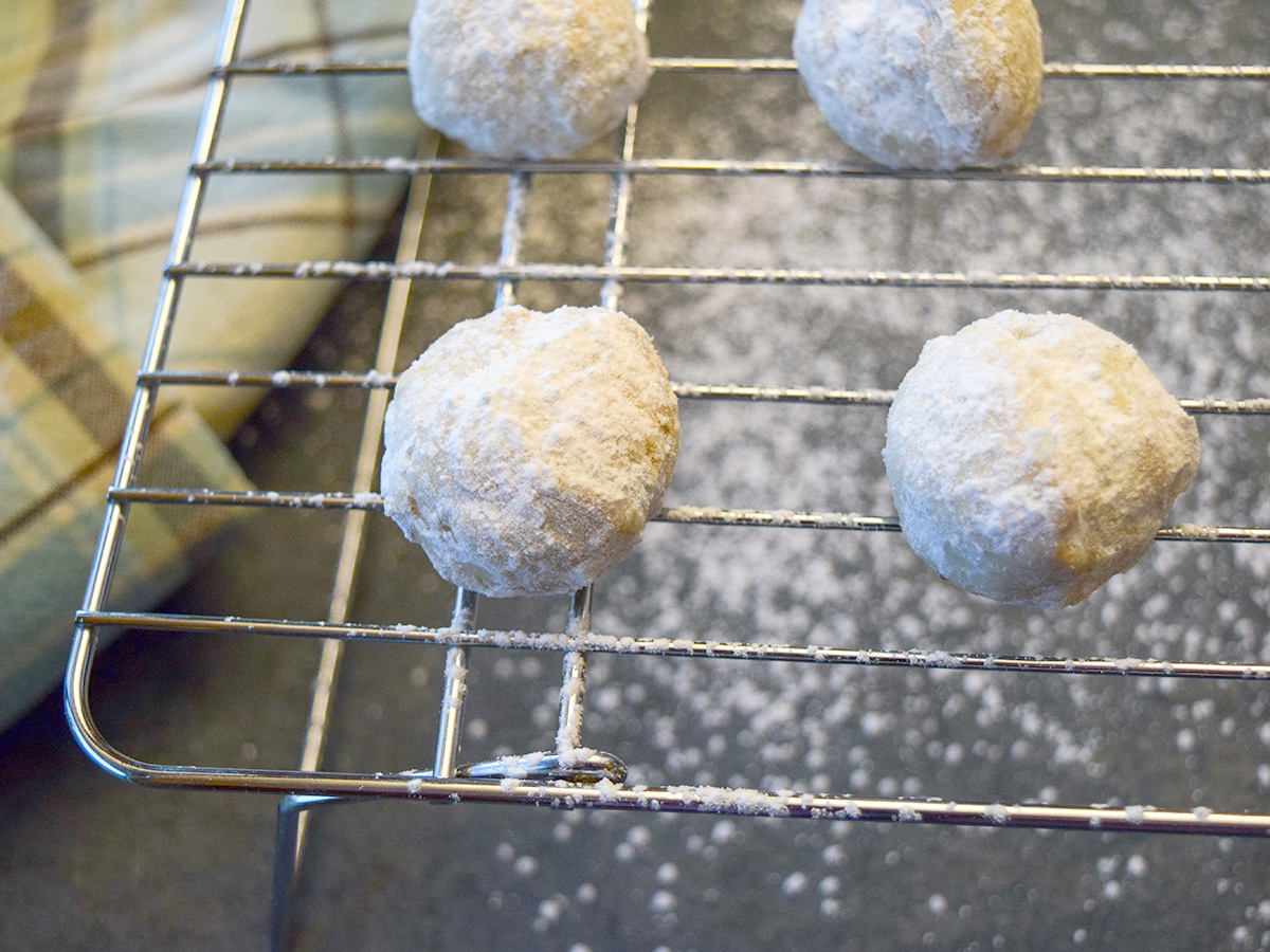 cookie balls on cooling rack
