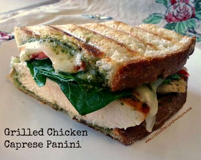 Grilled Chicken Caprese Panini- A grilled or pan fried chicken breast with pesto, spinach, mozzarella, and tomato. All the things you love about a caprese salad on a sandwich. #sandwich #realfood #indoorgrill #pressedsandwich