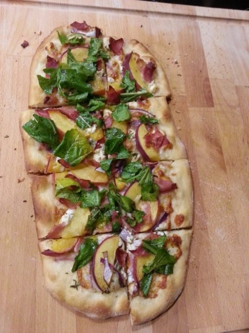 Balsamic Peach and Prosciutto Pizza- A tasty pizza with fresh peaches, prosciutto, and balsamic dressed arugula. Perfect for quick meals, parties, appetizers, or snacks. #realfood #cleaneating #healthyrecipe