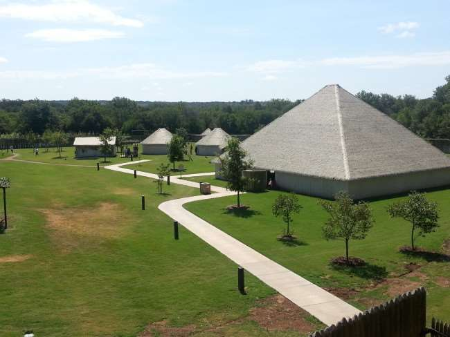 Chickasaw Cultural Center building in a grassy area with a path
