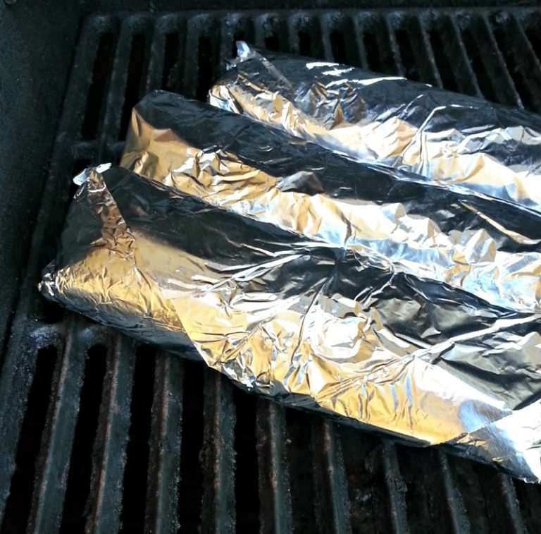 buritos wrapped in foil on grill