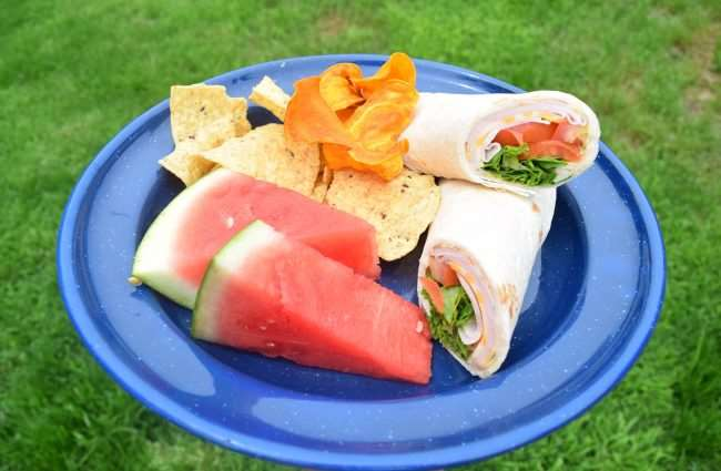 Tortilla Wraps for lunch before you leave your camp site to head home. | Herb Chicken and Veggie Foil Packet Dinner | Cold Cut Sandwiches are an easy meal for camping | Camping Food: Meal Plan, Recipes, & Tips for a Weekend Campout | Everything you need to cook great food on your next campout; menu, printable grocery list, recipes, etc.