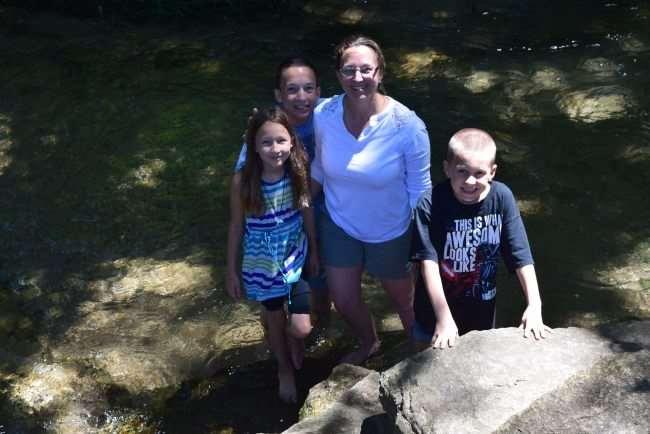 family in creek
