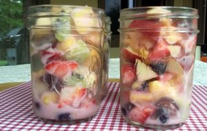 Creamy Summer Fruit Salad served in mason jars makes them perfect for summer BBQs or parties. Made with fresh fruit and Yoplait Yogurt #sponsored #ad