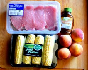 Spicy Grilled Pork Chops with Cinnamon Peaches and Corn on the Cob - Grilling is made easy with @ALDIUSA. They have everything you need to fire up the grill and save you money on groceries too. #summergrilling #ad #campfood