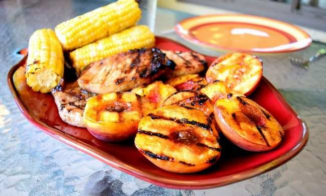 Spicy Grilled Pork Chops with Cinnamon Peaches and Corn on the Cob - Grilling is made easy with @ALDIUSA. They have everything you need to fire up the grill and save you money on groceries. #summergrilling #ad #campfood