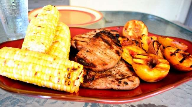 Spicy Grilled Pork Chops with Cinnamon Peaches and Corn on the Cob