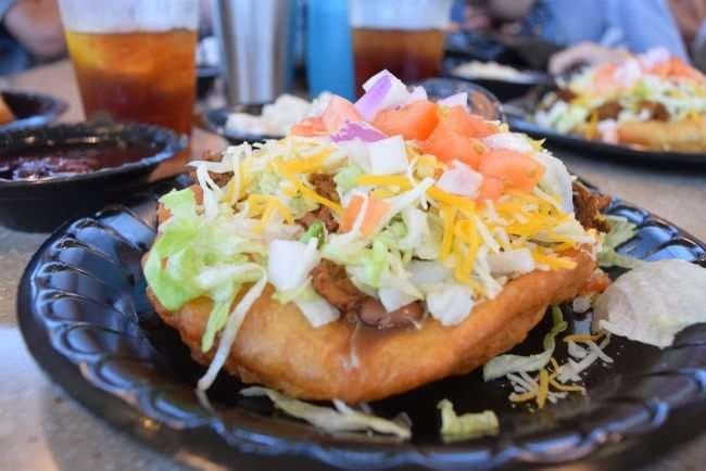 Indian Taco - fry bread topped with beef, lettuce, cheese, and tomato