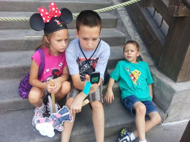 Kids playing Agent P in EPCOT