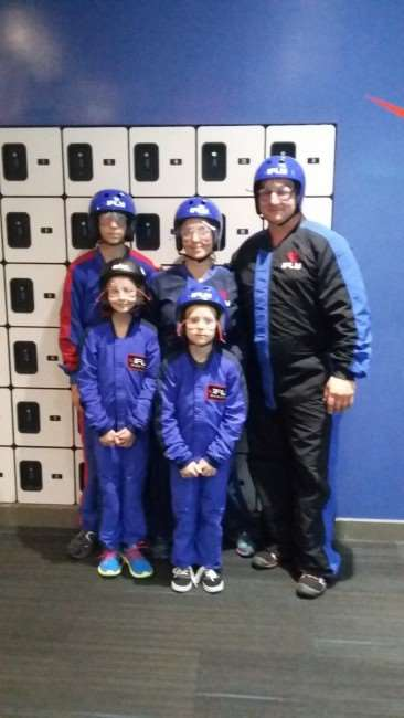 Family suited up for indoor skydiving