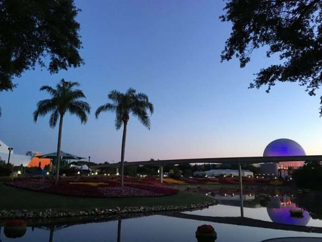 Sun rising over EPCOT's Spaceship Earth - Discovering magic at Disney World - if you get the chance to do a family fun run at Disney, do it. The memories you create are magical