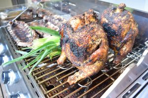 Beer Can Chicken with Coffee Brown Sugar Rub - A tasty recipe for grilled/smoked chicken that is ALWAYS moist and delicious