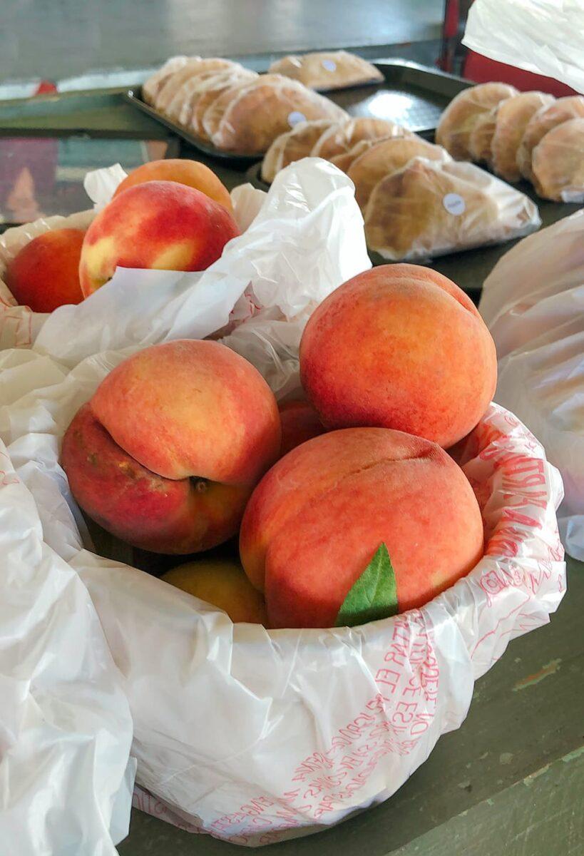 fresh peaches in a bag basket