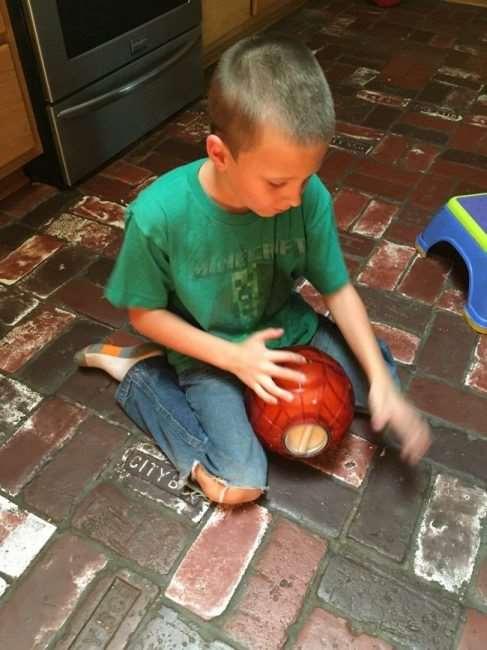 boy on floor with ice cream ball