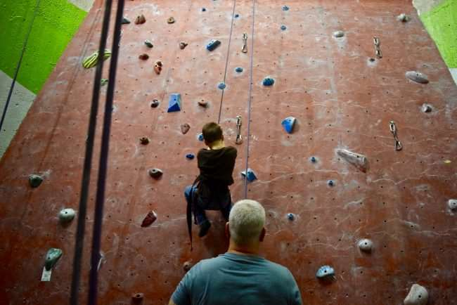 Father and son indoor climbing