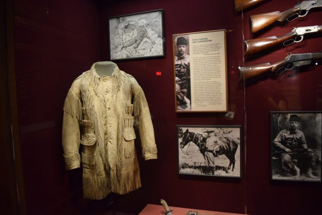 Theodore Roosevelt exhibit with a leather coat and muskets