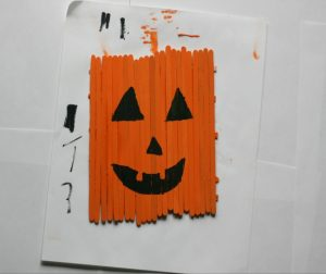 Check out this DIY popsicle stick pumpkin for a great craft to do with your kids for halloween.