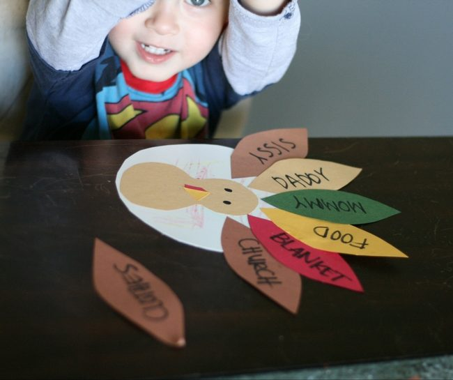 boy making Turkey Craft