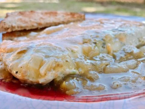 Omelete smoothered in green chile