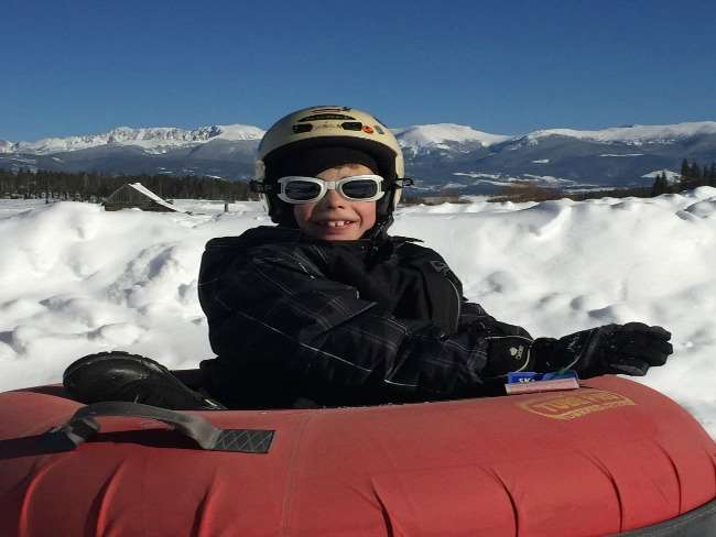 winter activity snow tubing fun for young and old