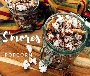Easy S'mores Popcorn Snack mix - Popcorn drizzled with chocolate topped with more chocolate chips, mini marshmallows, and crushed graham crackers will rock your taste buds!