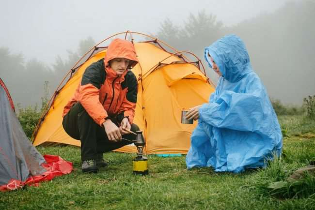 Campers staying dry in rain jackets - Things to remember when Spring Camping with Your Family
