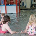 family in hot springs pool