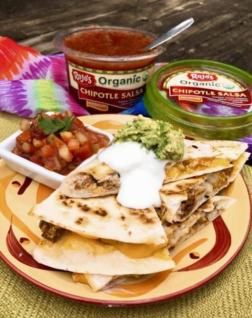 Sausage and Egg Breakfast Quesadillas - This is a delicious twist on breakfast burritos with mounds of ooey-gooey cheese, breakfast sausage, and scrambled eggs. Create these at home or while camping in a cast iron skillet. #breakfast #campingrecipe #campingbreakfast