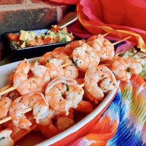 Host the Ultimate Cinco de Mayo Party with these tips and recipe for skewered Shrimp Tacos - A Taco Bar is a fun party idea and we'll show you how to do it