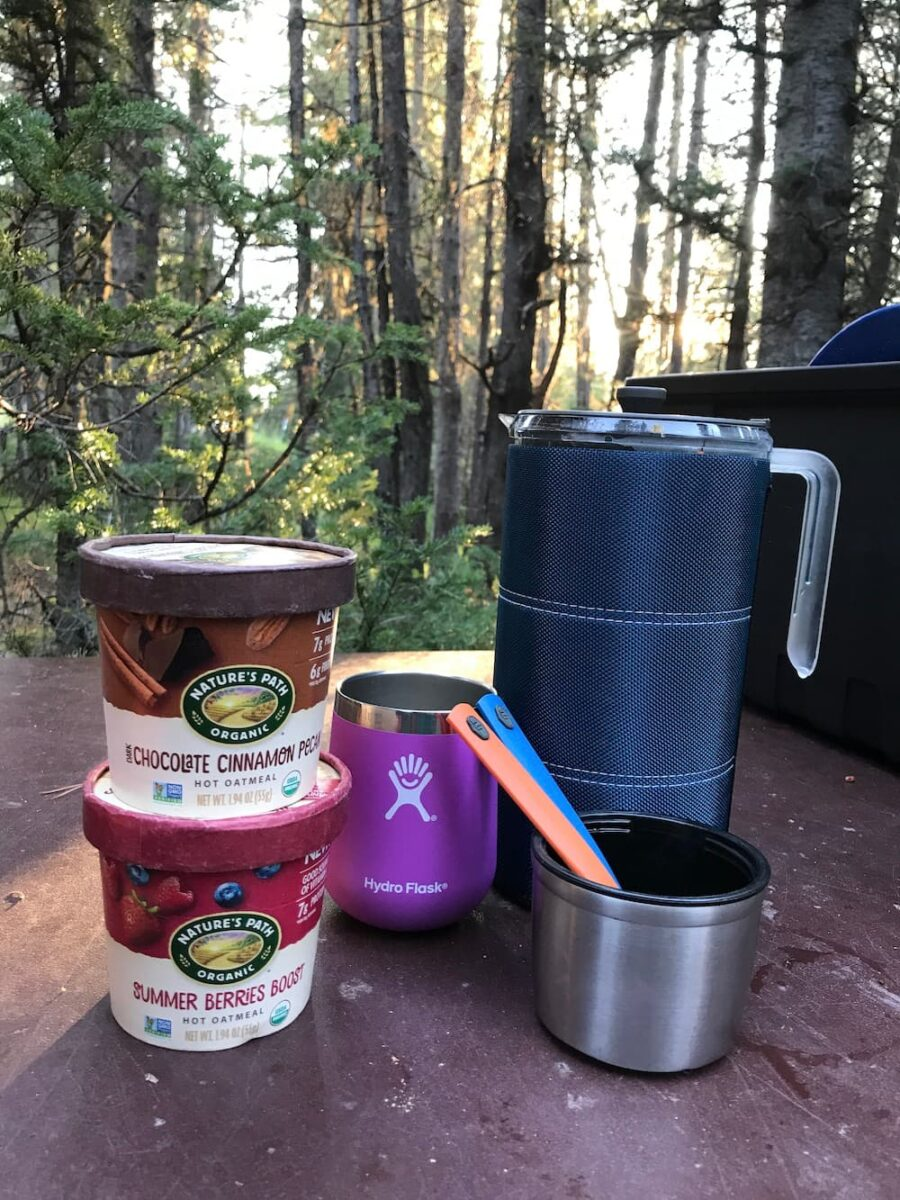 camp french press, oatmeal cups, spoons, and mug