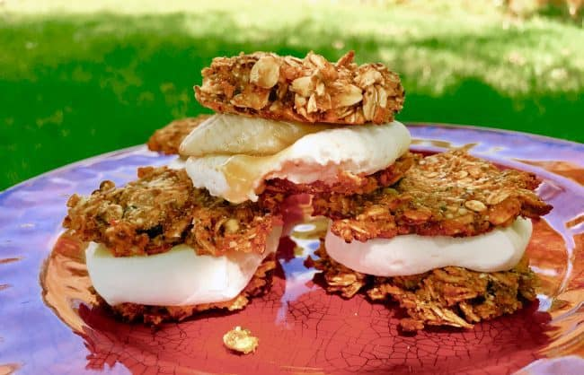 Instead of classic S'mores, mix things up with these gluten free Banana Honey S'mores on Trail Mix cookies. These camping snacks/desserts are vegan and made without refined sugar. Made with Wedderspoon Manuka Honey. Kids and adults eat them up.