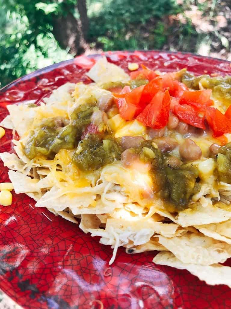 nachos witj cheese, green chile, beans, and tomato
