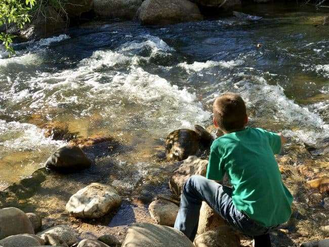 Creek running with boy alongside