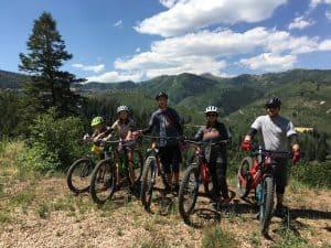 Family on mountain with mountain bikes
