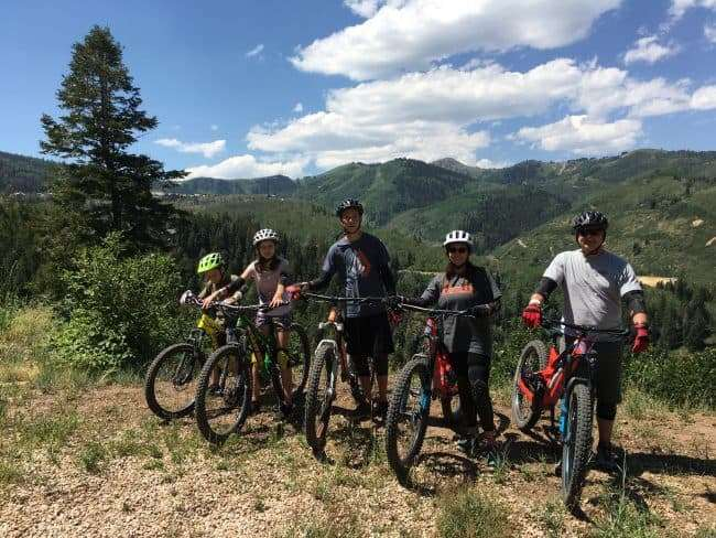 Family on mountain with mountain bikes