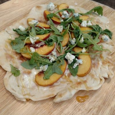 This Dutch Oven Pizza with Peaches & Honey Recipe Will Blow Your Mind
