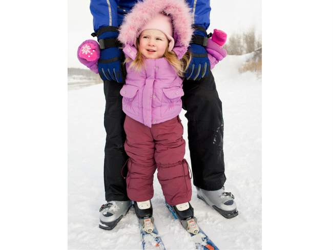 Toddler Skiing with adult