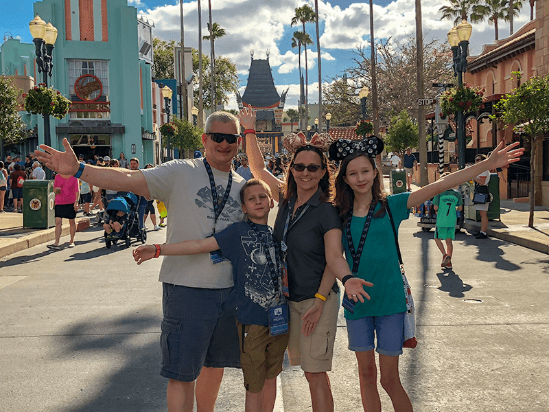 Family posing for pictures in Disney World's Hollywood Studios