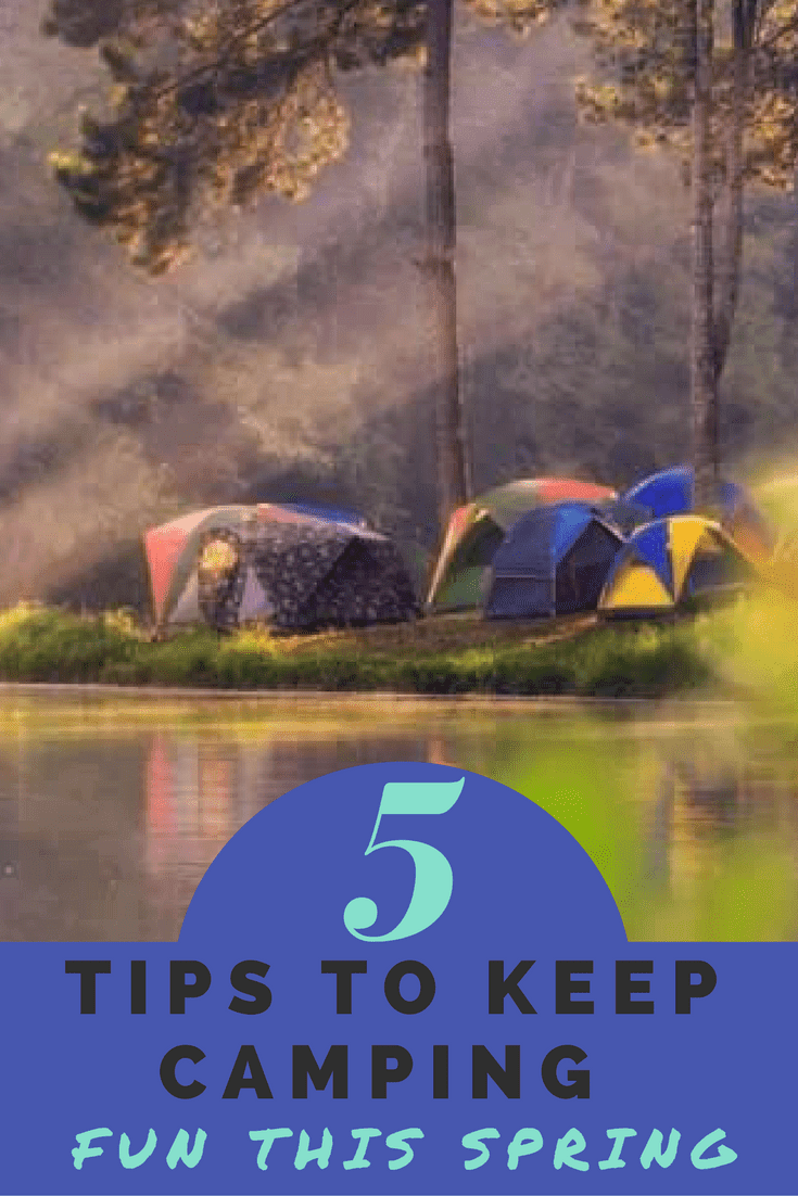 Tents set up by a river - Things to remember to keep spring camping fun with kids