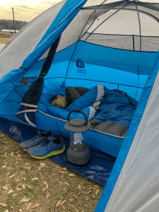 boy sleeping inside a tent