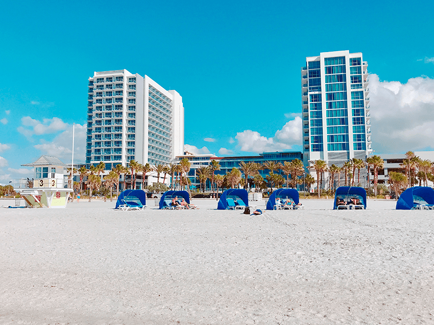 white sand beaches and covered cabanas along the beach- In front of the Wyndham Grand Resort in Clearwater Beach, Florida