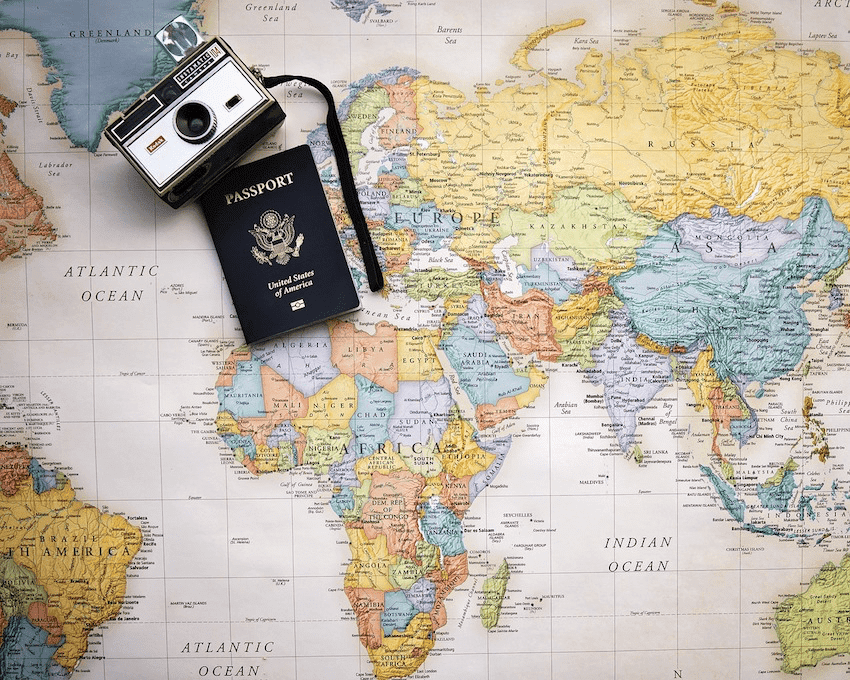 international map with passport and camera -
