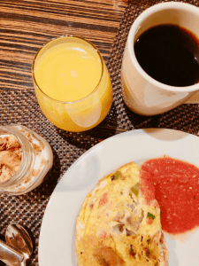 Hearty Breakfast with omelet, yogurt, juice, and coffee from Anaheim Hilton