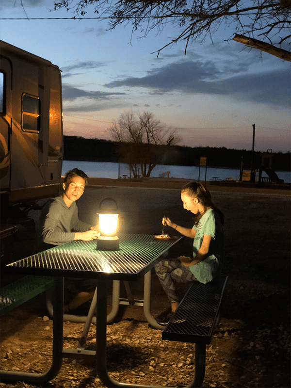 older children rving and eating outdoors
