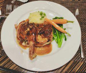 Rotisserie Chicken half with vegetables