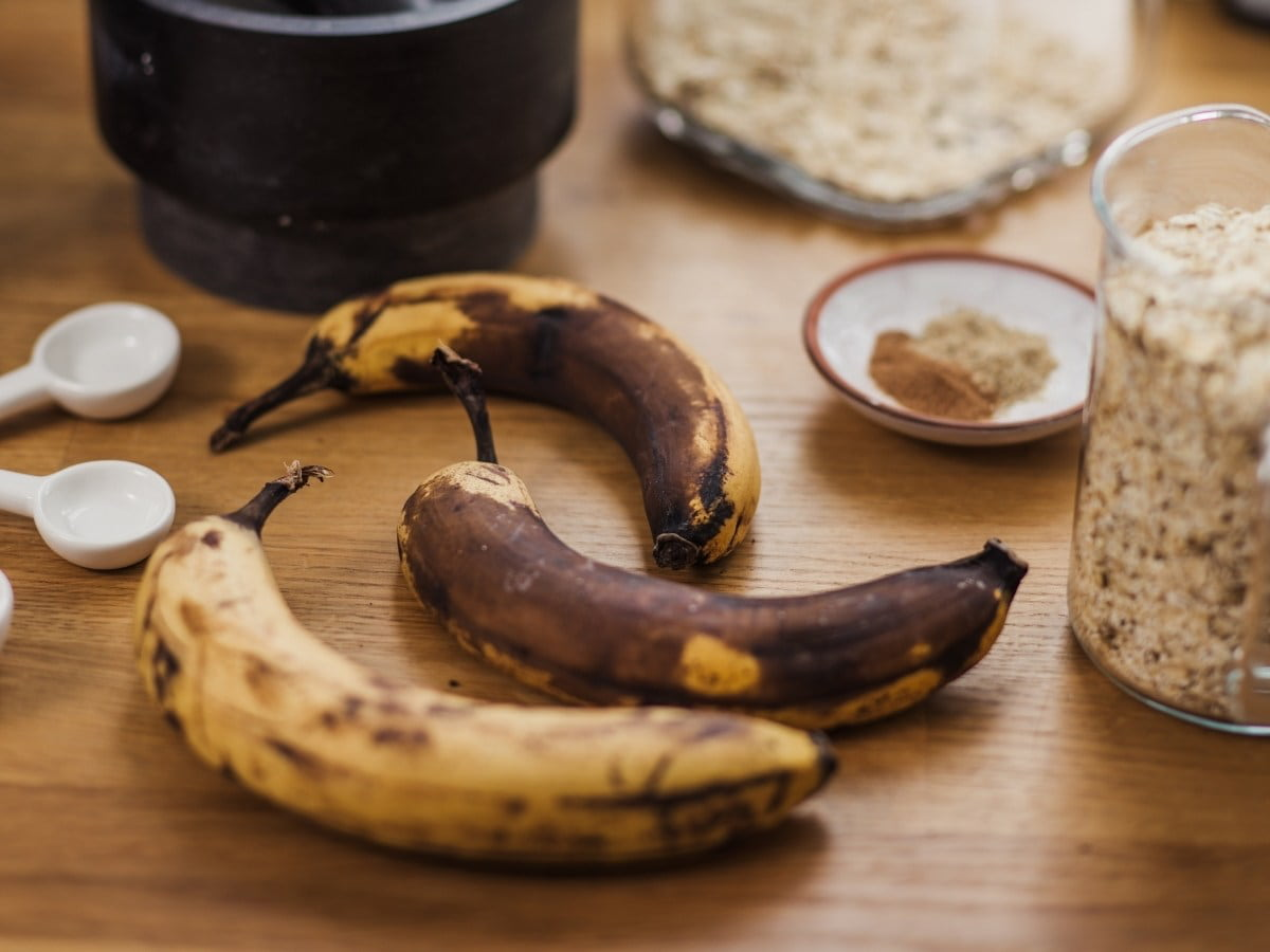 ripe bananas next to baking ingredients